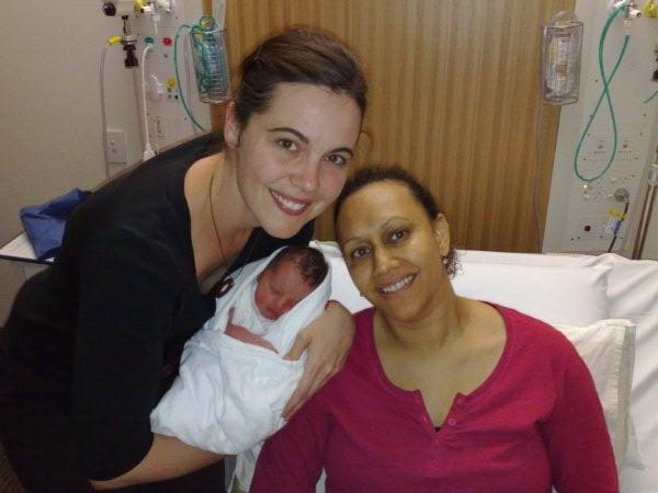 Melinda with Karen, her doula, who is holding brand new baby Tion.